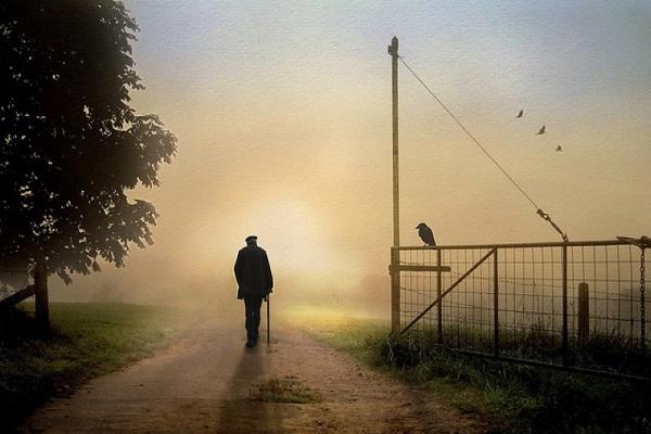 Old man walking away